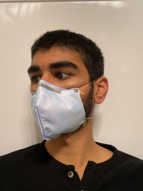 Shiv Patel models one of the DIY masks being developed by the Human-Centered and Ubiquitous Computing Lab and others.