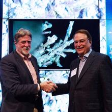 UW's John Delaney and CSE's Larry Smarr celebrate delivery of remote-controlled HD video live feed.